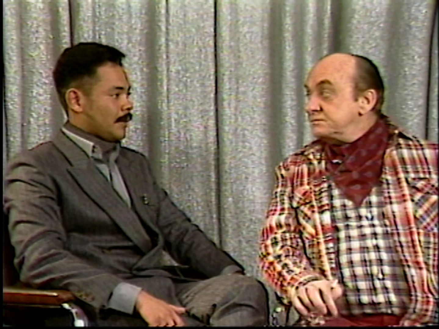 George Sardi interviews fashion designer Gillman Sang. 1985. U-matic tape. Still from the item Gay Morning America, Season 2, Show 15.